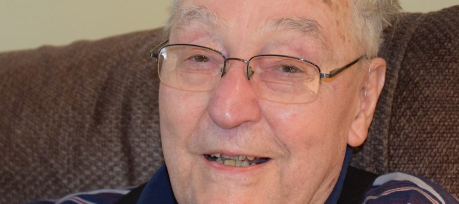99-year-old retired professor, Henry Orr, smiling for the camera.
