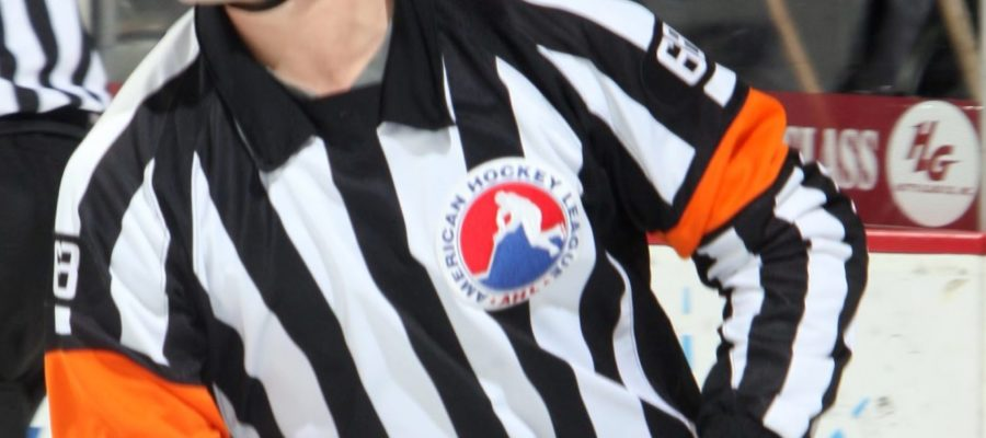 A hockey referee in action