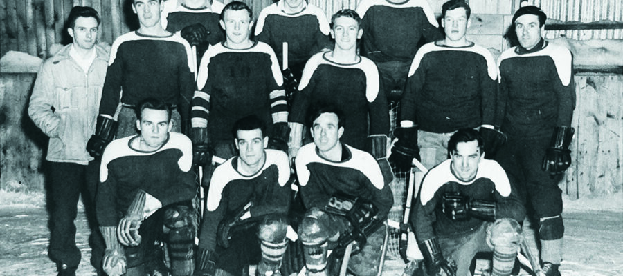 Members of the OVC '51 hockey team celebrate their win in the 1947-48 OAC/OVC tournament.