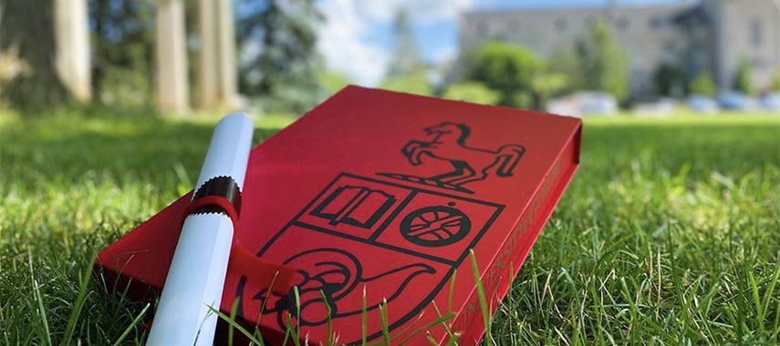 convocation keepsake boxes in the grass on Johnston Green
