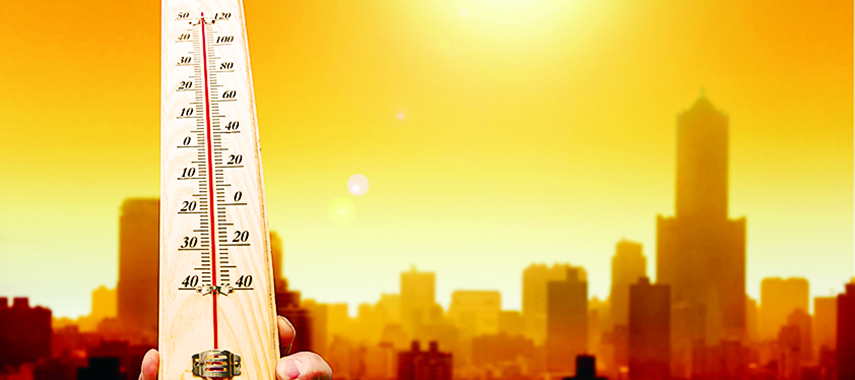 thermometer with hot city background
