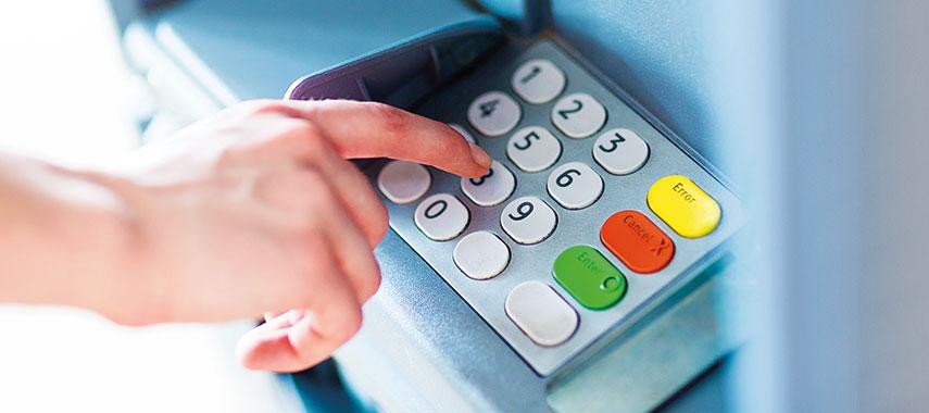 entering pin on cash machine